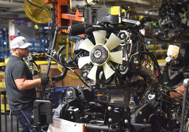 Shawn Swafort attaches a motor to the chassis in the motor-set area of final assembly at Flint Assembly, Tuesday, February 5, 2019. The media takes a tour of final assembly, the body shop and the paint shop.