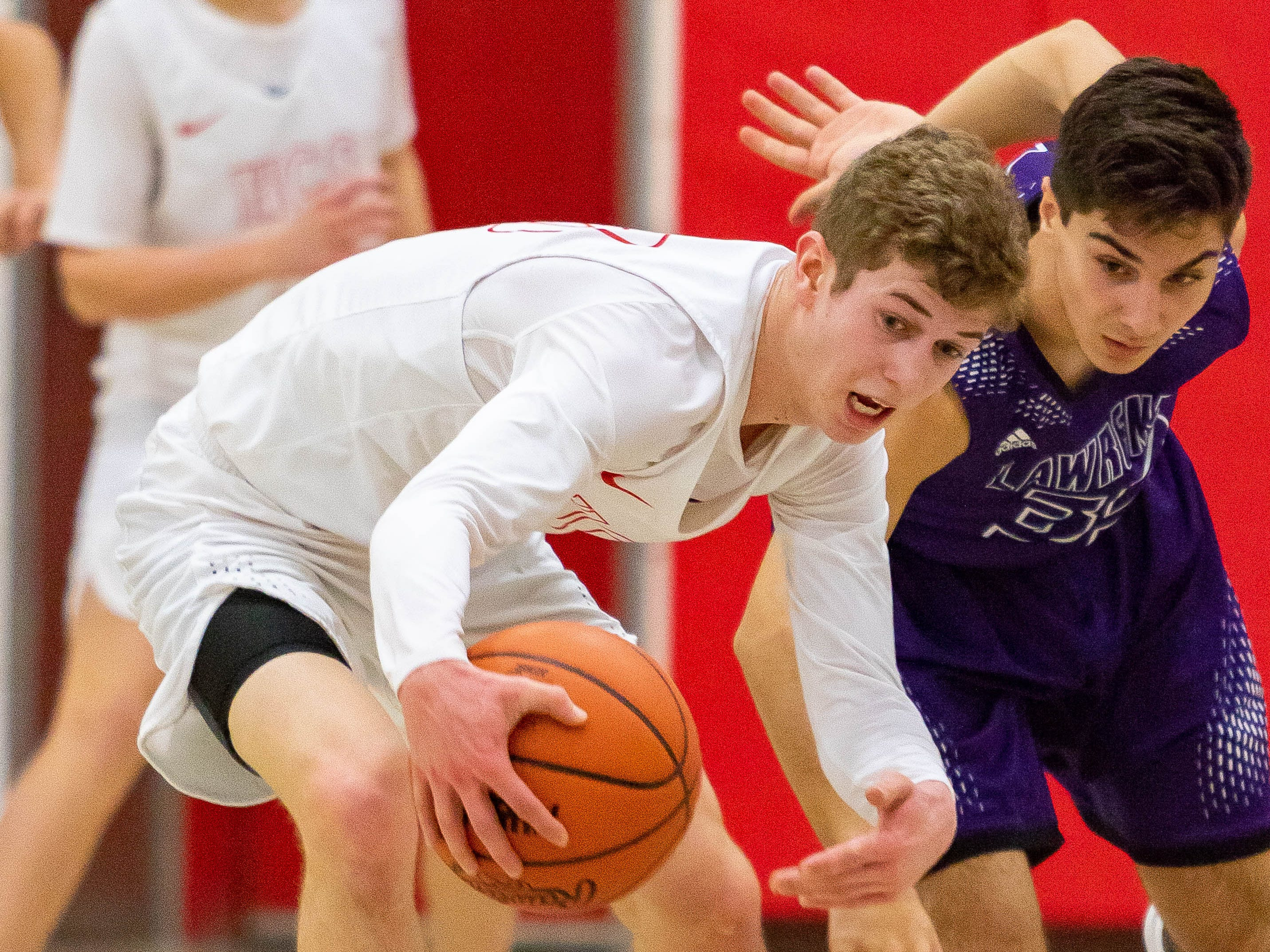 Marcellus Howardsville Christian's Dylan Jergens steals the ball during a game against Lawrence.