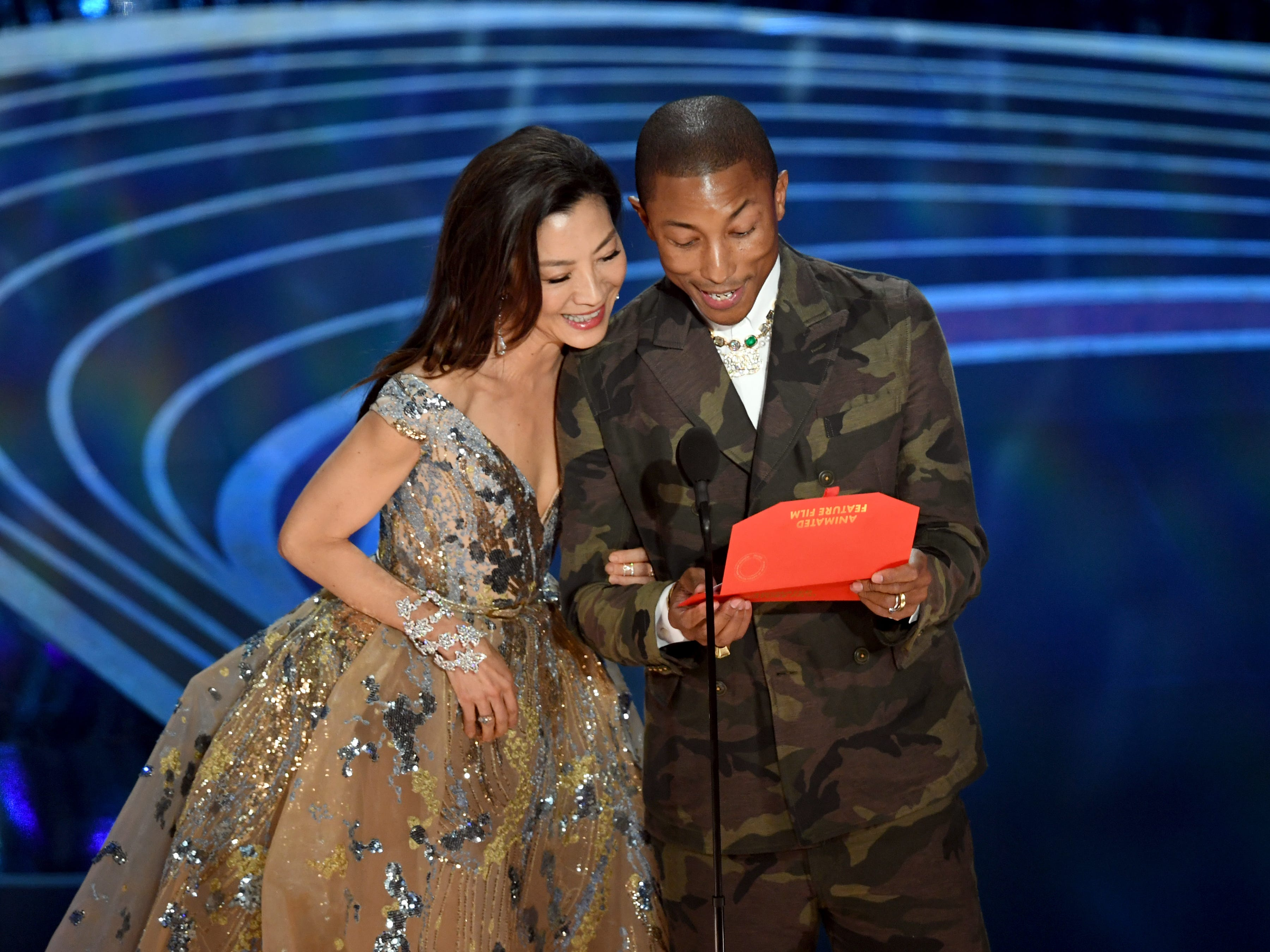 Michelle Yeoh and Pharrell Williams speak onstage during the 91st Annual Academy Awards.