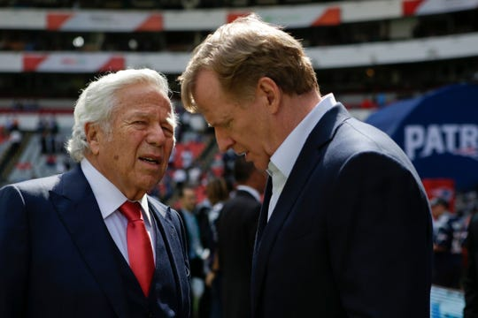 NFL commissioner Roger Goodell, right, talks with New England Patriots owner Robert Kraft.