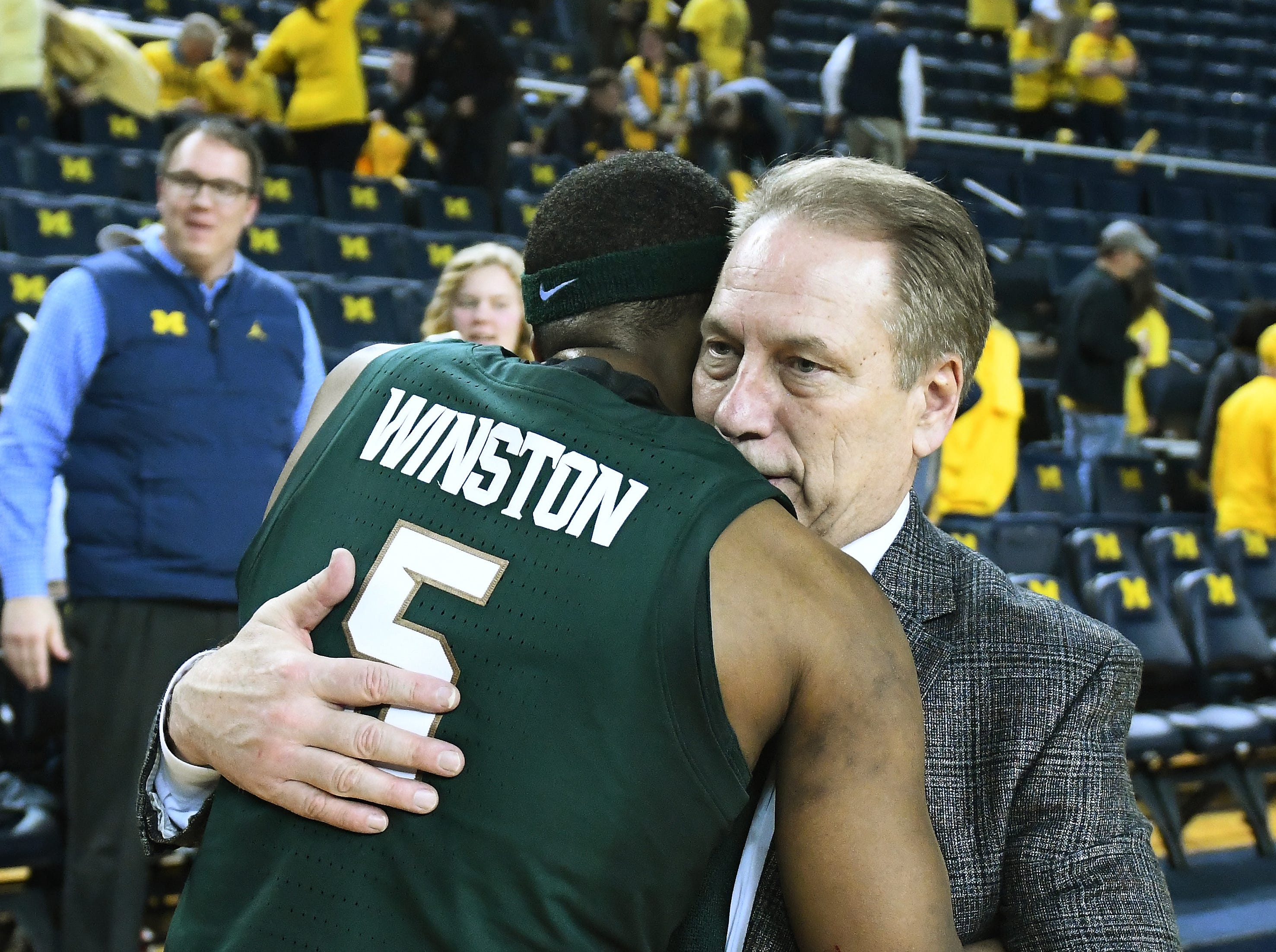 Michigan State's Cassius Winston gets a hug from coach Tom Izzo after the State victory. Michigan's in the second half. University of Michigan vs. Michigan State at Crisler Center in Ann Arbor, Michigan on February 24, 2019.  (Image by Daniel Mears / The Detroit News)  77-70