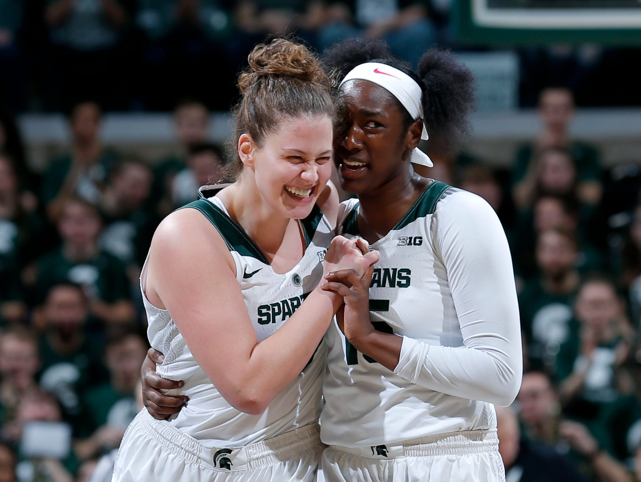 Michigan State's Jenna Allen, left, and Victoria Gaines celebrate during the first quarter.
