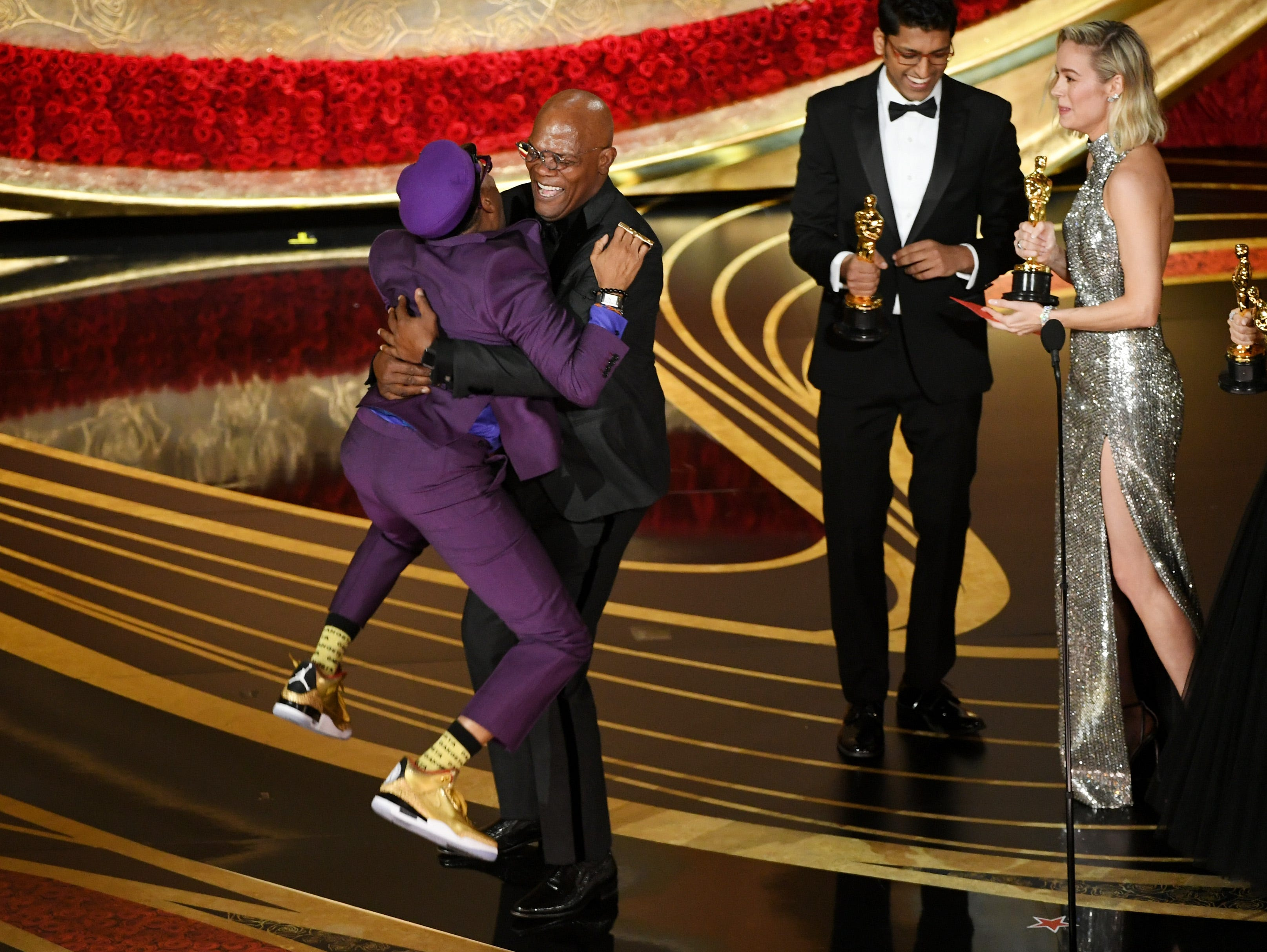 "Spike Lee accepts the Best Adapted Screenplay award for ""BlacKkKlansman"" from Samuel L. Jackson onstage during the 91st Annual Academy Award."