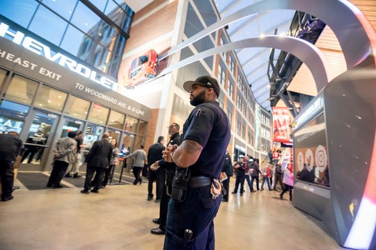 A Detroit police officer monitors an entrance on the concourse level of Little Caesars Arena before the start of a Feb. 20 game between the Detroit Red Wings and the Chicago Blackhawks.