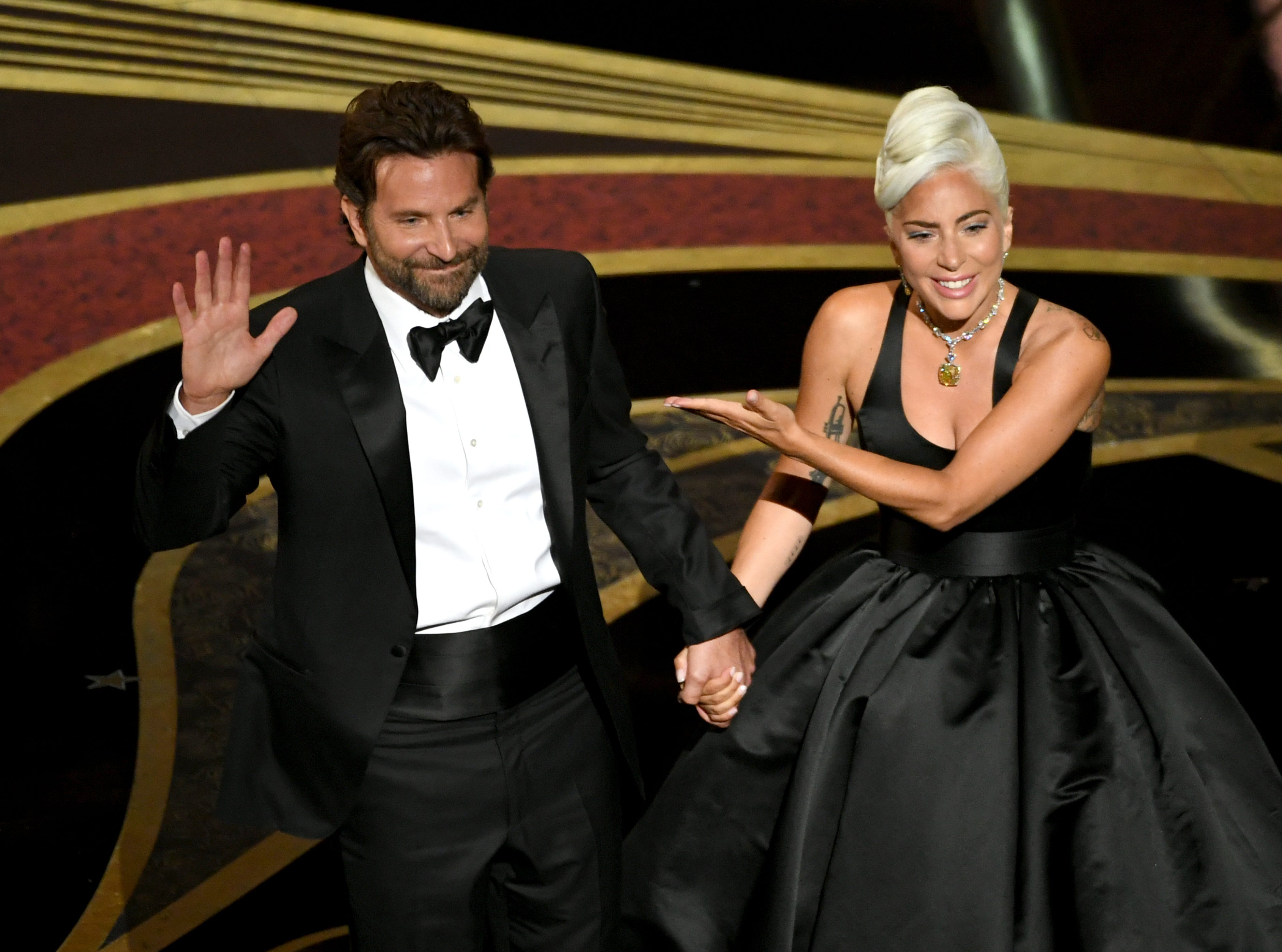 Bradley Cooper and Lady Gaga take a bow after performing onstage during the 91st Annual Academy Awards.