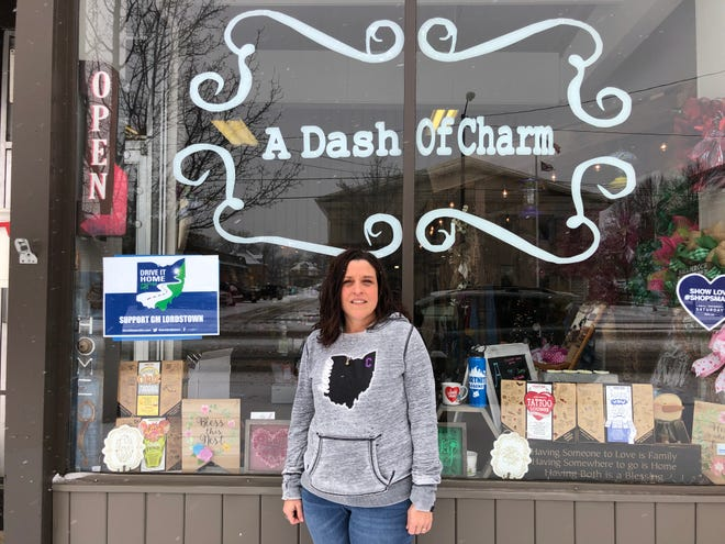 Heather Quinby, a former GM Lordstown employee and current owner of craft store A Dash of Charm in Warren, Ohio, stands in front of her store on High Street on Feb. 19, 2019.