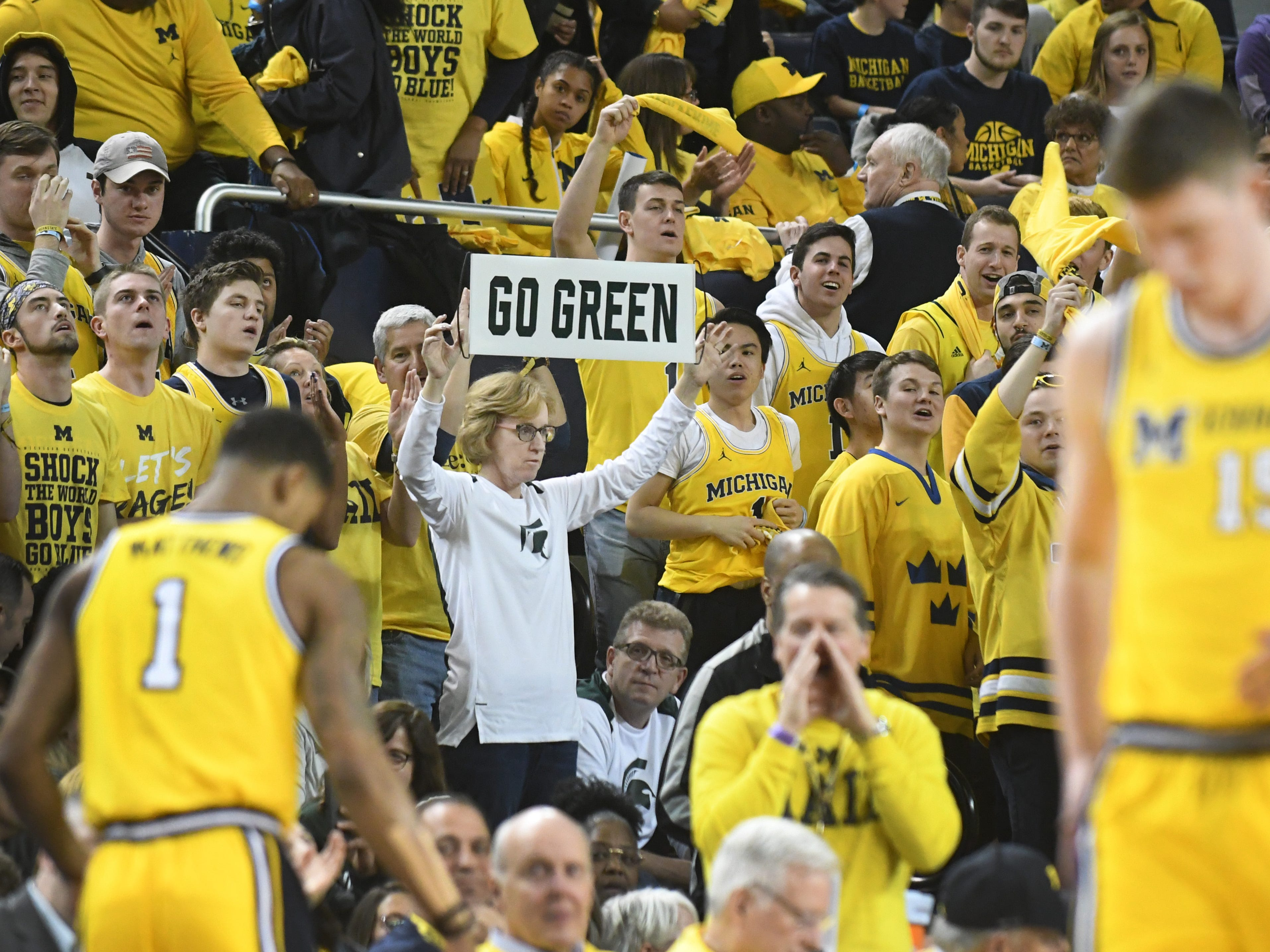 A sparse Michigan State fan in the sea of maize and blue.