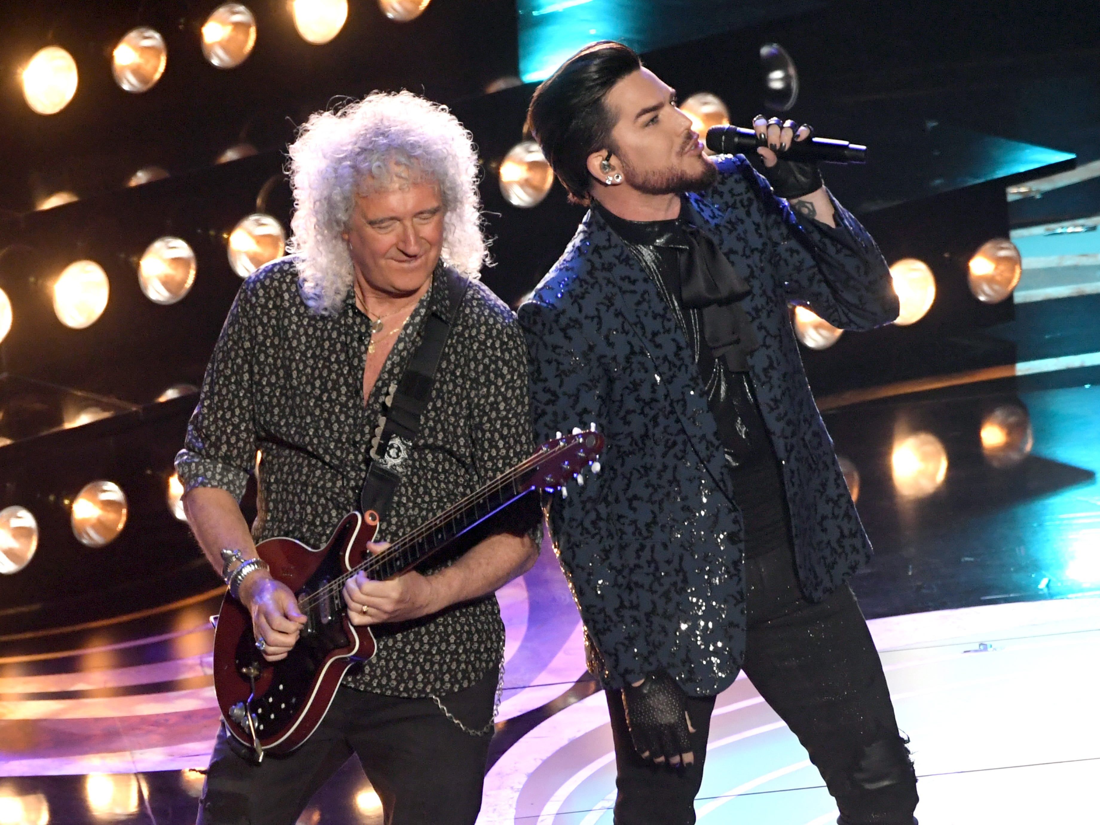 Adam Lambert (L) and Brian May of Queen perform onstage during the 91st Annual Academy Awards.