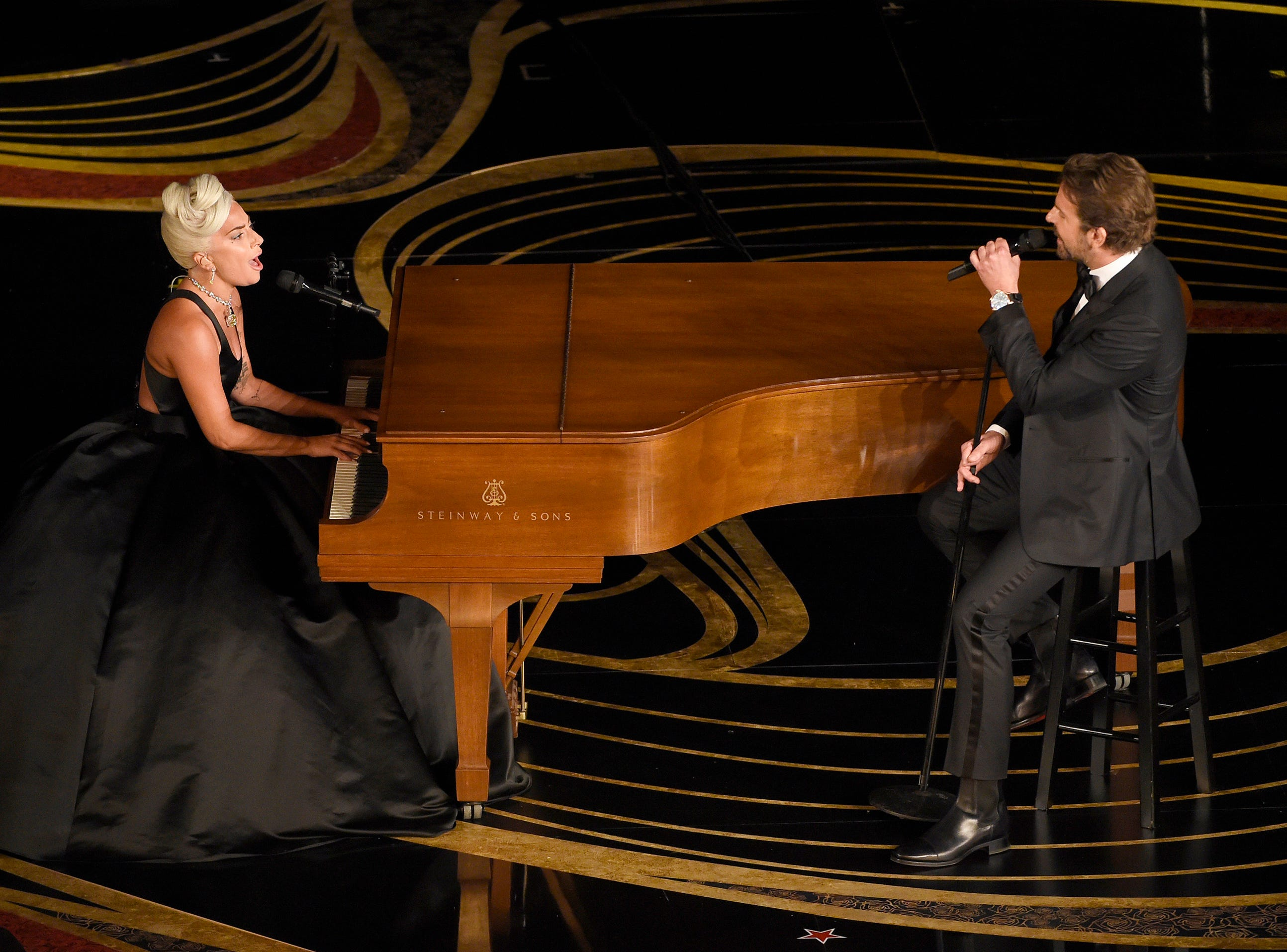 "Lady Gaga, left, and Bradley Cooper perform ""Shallow"" from ""A Star is Born"" at the Oscars."