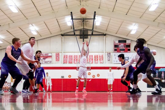 Dylan Jergens attempts a free throw at Howardsville Christian in Marcellus in their game Saturday against Lawrence.