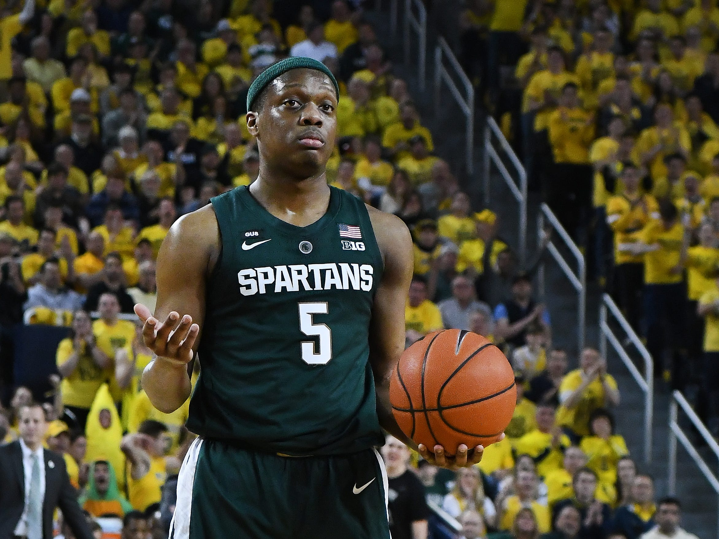 Michigan State's Cassius Winston questions a call in the first half.