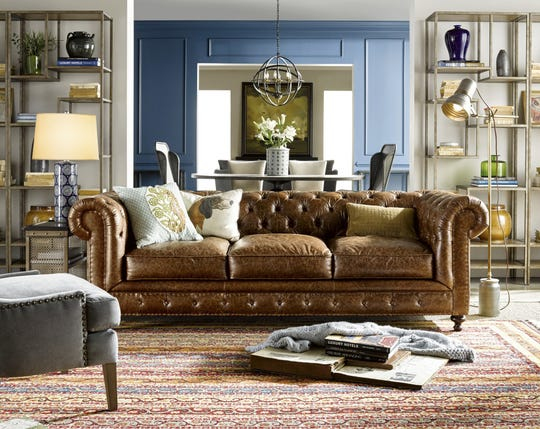 A statement piece like a leather chesterfield sofa can provide a focal point in a room filled with matching furniture.