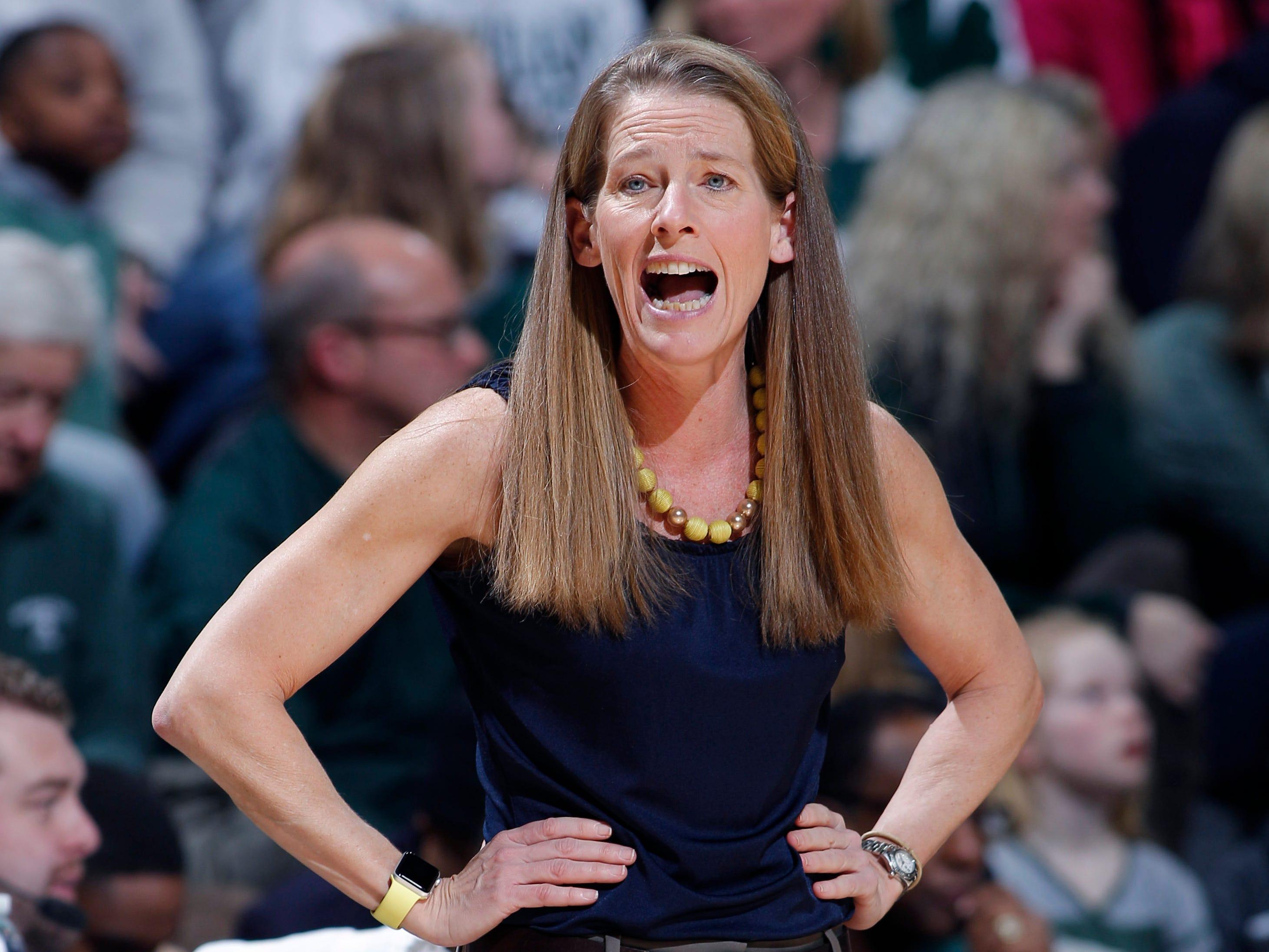 Michigan coach Kim Barnes Arico shouts from the Michigan bench.