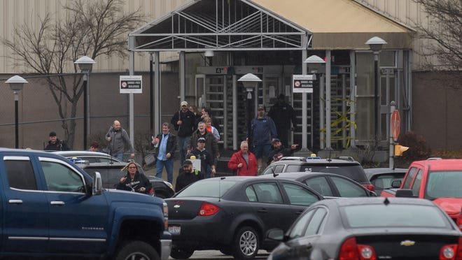 Employees leave the GM Lordstown Plant on November 26, 2018 in Lordstown, Ohio. GM said it would end production at five North American plants including Lordstown, and cut 15 percent of its salaried workforce. The GM Lordstown Plant assembles the Chevy Cruz.