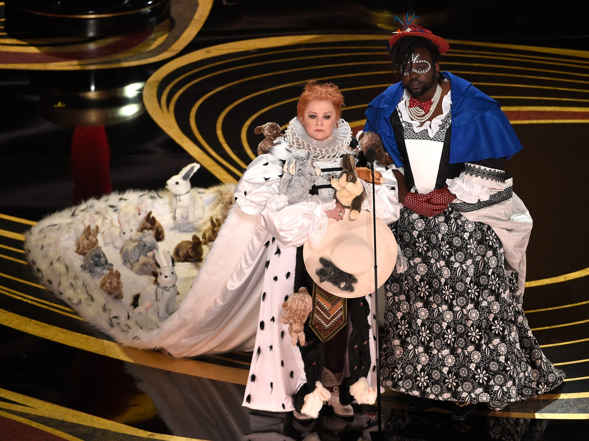 Melissa McCarthy, left, and Brian Tyree Henry present the award for best costume design at the Oscars.