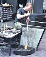 Eric Meek, senior manager of hot glass programs at the Corning Museum of Glass, works on a piece of blown glass at the museum on Feb. 19.