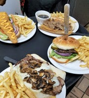 Nellie's sandwiches heading for the table, from upper left: Spicy fish po' boy, Italian beef, burger, and ribeye steak.