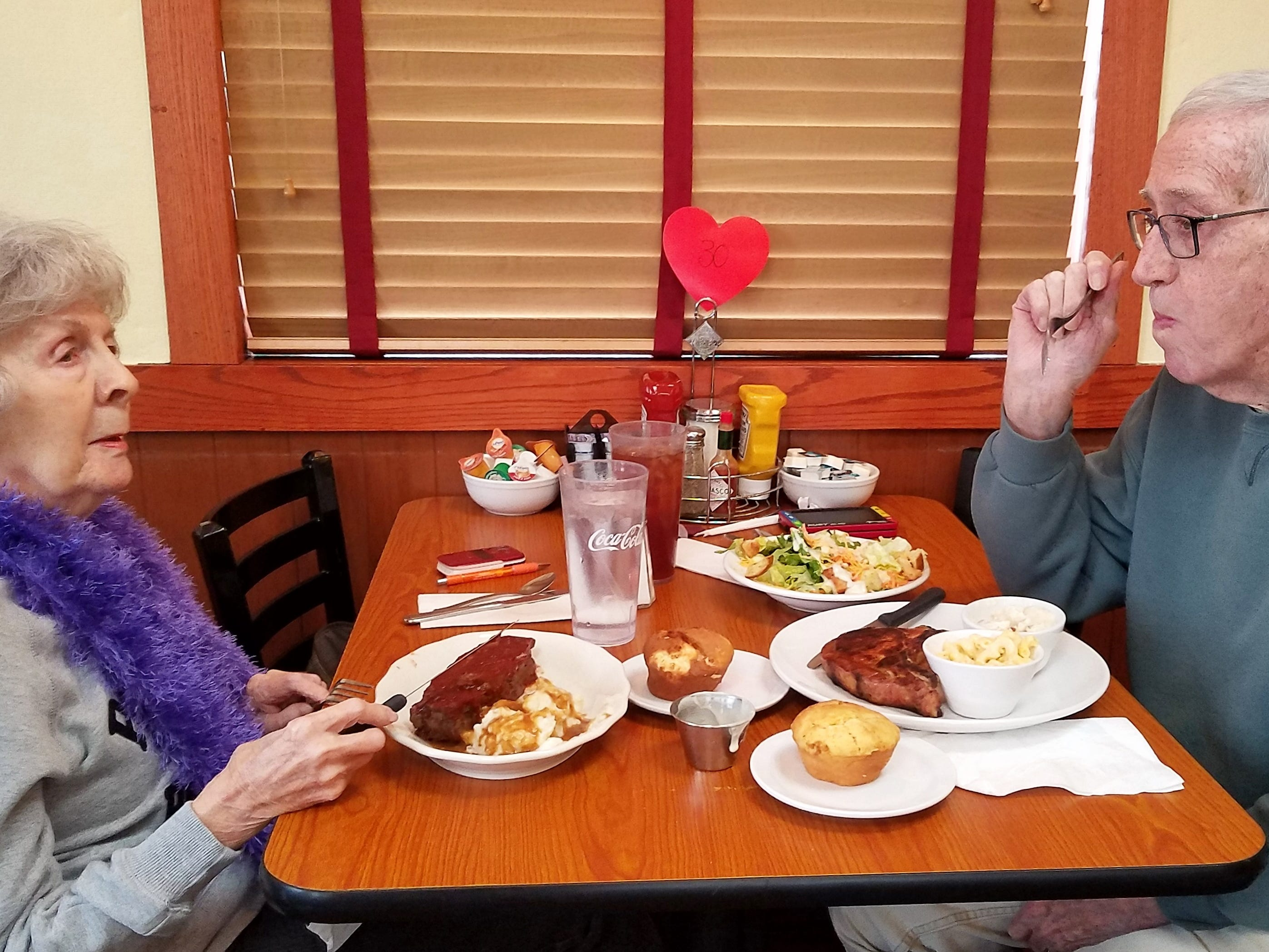 Kay Lant and Jim Hungate of Newburgh enjoy Nellie's new dinner hours with meatloaf and a grilled chop.