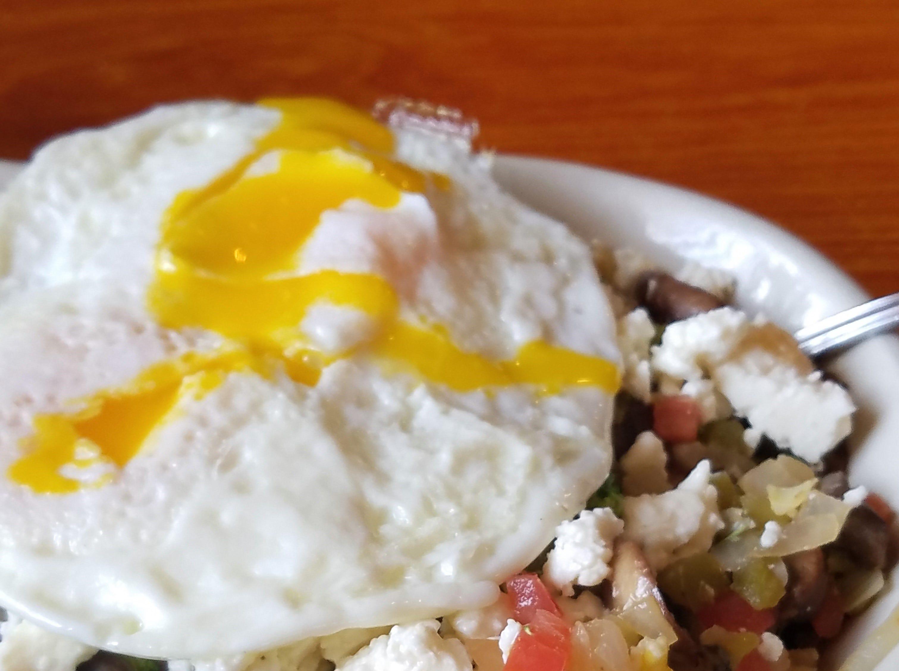 Veggie breakfast skillet with over-easy egg at Nellie's Restaurant.