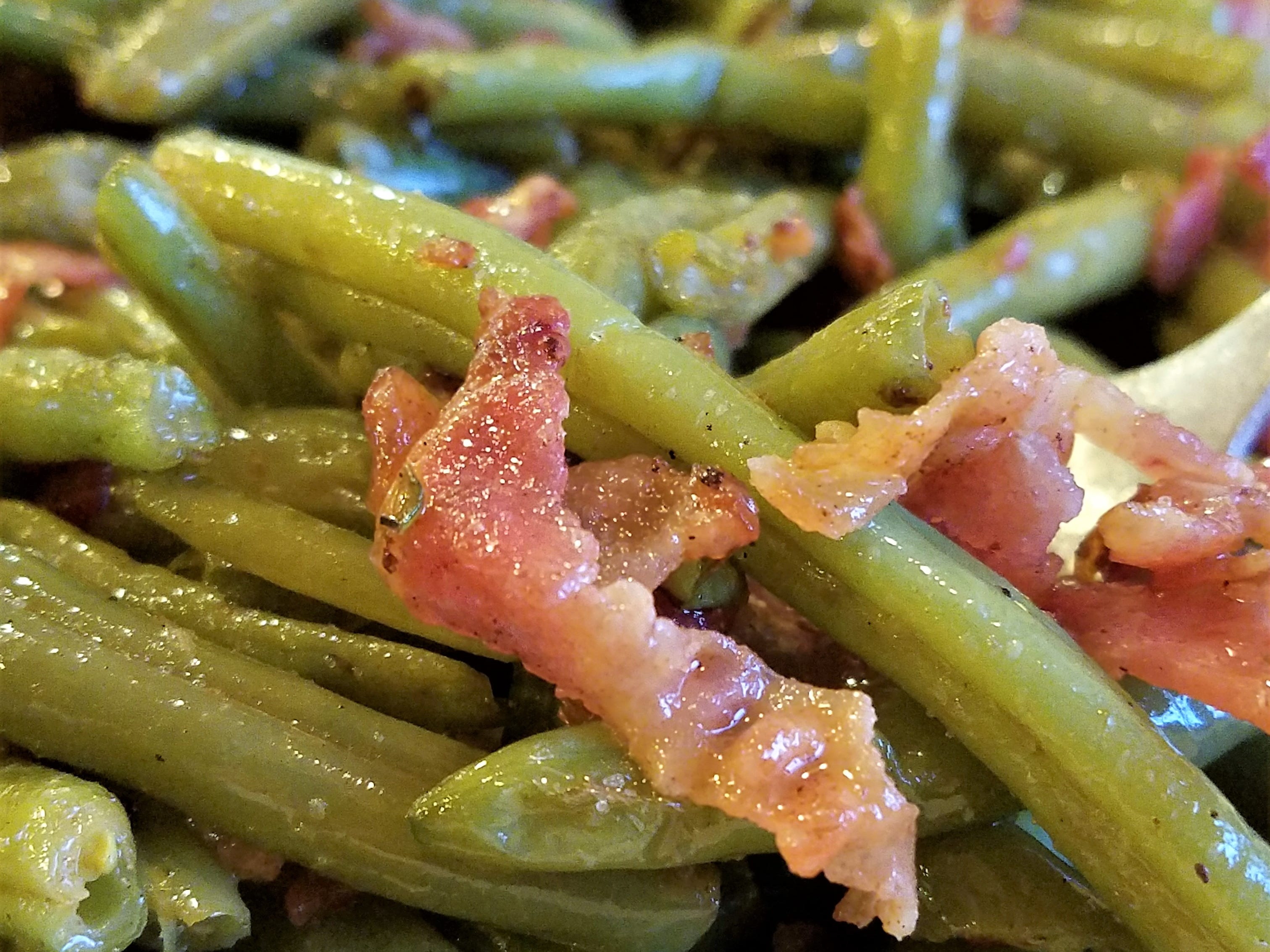 Nellie's green beans are a special treat. They're bright green, lightly cooked, and finished with lots of crispy bacon.
