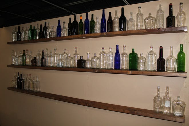 """These 90 bottles represent the average annual liquor consumption of an American citizen during President Rutherford B. Hayes' term as president. The bottles are part of a re-created late 19th century tavern featured in the special exhibit """"Demon Rum & Cold Water: The Two Sides of Temperance"""" at the Hayes Presidential Library and Museums."""