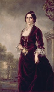 """The Women's Christian Temperance Union paid for this portrait of First Lady Lucy Hayes because of her involvement in the temperance movement. This portrait was painted during the Hayes Administration in the White House. The velvet dress she is wearing in the portrait will be on display in the special exhibit """"Demon Rum & Cold Water: The Two Sides of Temperance,"""" opening Friday and running through Oct. 6 at the Hayes Presidential Library and Museums."""