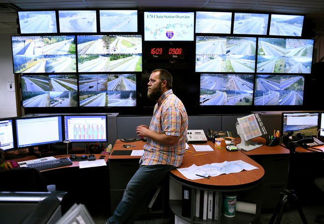 In this Sept. 8, 2017, photo, Craig Pike monitors traffic from a Colorado Department of Transportation office at the mouth of two tunnels bored under the Continental Divide. In 2018, about 13.4 million vehicles on I-70 crossed the Continental Divide, which slices through the heart of Colorado's ski country. (AP Photo/Thomas Peipert)