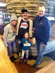 Kristen Schulz, left, Jedediah Schulz and Paul Meleen, lodge owner, with Violet Schulz in front.