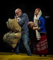 "Playing Arab refugees, Dan Sallinen and Erin Tauscher labor with their possessions in a scene from Biba Sheikh's ""Right to Live,"" on stage March 1 to 3 at Third Avenue  Playhouse."