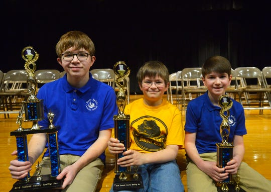 Cascade County Spelling Bee top three finishers from left to right: first place winner Jamie MacDonald, Holy Spirit; second place winner David Wolfe, Lincoln Elementary; third place winner Connor Sturges, Holy Spirit.