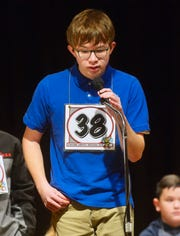 Holy Spirit eighth grader Jamie McDonald spells a word in an early round of the Cascade County Spelling Bee on Monday morning at West Elementary School.
