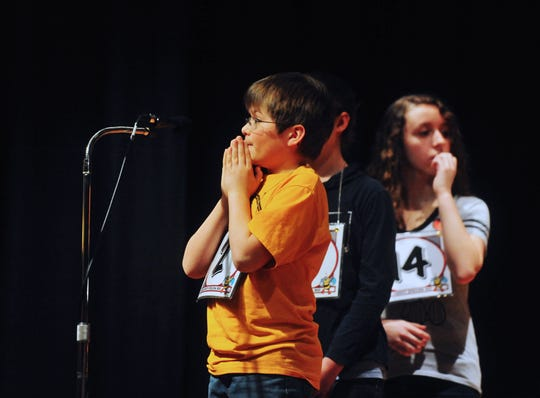 """Lincoln Elementary School sixth grader David Wolfe looks to the judges after spelling a word during the Cascade County Spelling Bee, Monday morning at West Elementary School.  Holy Spirit Catholic School eighth grader Jamie MacDonald won the competition with the word """"Paparazzo""""."""