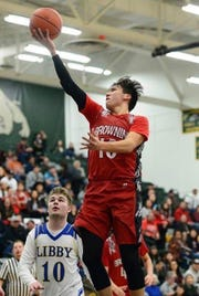 Browning sharpshooter Riley Spoonhunter goes up for two against the Libby Loggers early this season. The former Heart Butte star broke the 1,000-point barrier against Libby during the Northwest A District Tourney.