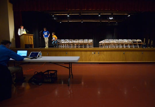 """The final two contestants in the Cascade County Spelling Bee, Monday morning at West Elementary School.  Holy Spirit Catholic School eighth grader Jamie MacDonald won the competition with the word """"Paparazzo""""."""