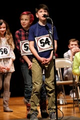 Holy Spirit sixth-grader Connor Sturges spells a word in an early round of the Cascade County Spelling Bee