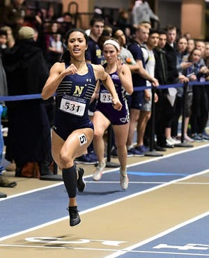 Regine Tugade, No. 5, regained the Navy record in the 200M sprint with a time of 24.46 seconds, set at the 2019 Boston University Last Chance Invitational on Feb. 24. She is shown here running in a previous meet.