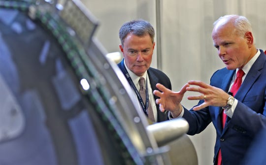 Mayor Joe Hogsett, left, and Rolls-Royce President of Defense Tom Bell talk about the F130 engine, after a campaign launch event at Rolls-Royce, Feb. 25, 2019.  Rolls-Royce Indianapolis hopes to win the competition to build about 650 F130 engines for the U.S. Air Force's B-52 aircraft.