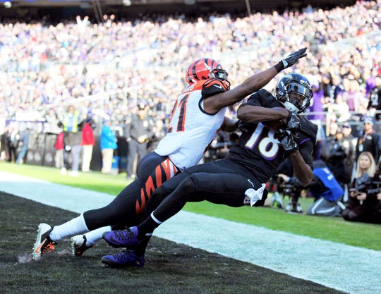 Nov 27, 2016; Baltimore, MD, USA; Baltimore Ravens wide receiver Breshad Perriman (18) catches a touchdown over Cincinnati Bengals cornerback Darqueze Dennard (21) in the first quarter at M&T Bank Stadium.