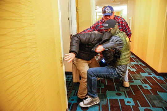 A man is surprised by two Delaware County sheriff's deputies as he knocks on a Muncie, Ind., hotel door on Tuesday, Jan. 30, 2018. The man resisted and was tackled to the ground in a scuffle that lasted approximately one minute. He was arrested but later released. No charges have been filed against him.