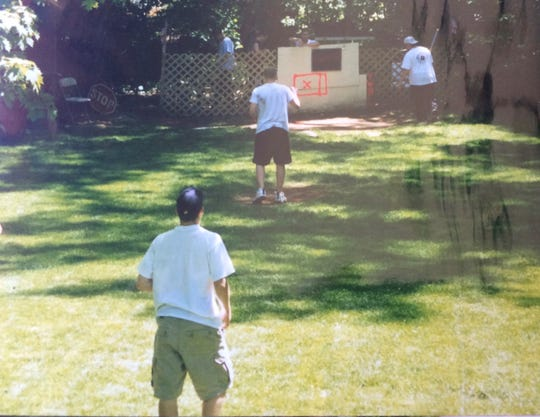 Derek Schultz, closest to camera,  plays second base during his backyard Wiffle ball career.
