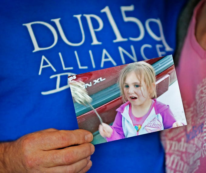 Dave Curtis holds a photo of his late daughter Charly, Thursday, Feb. 21, 2019. Charly was born with a genetic condition that eventually led her to develop grand mal seizures. After trying many medications that would work at first then become ineffective, they eventually tried treating her with THC, which has been known to help children with seizures.  But in Indiana, that meant going through a lot of bureaucratic red tape.  When their THC was about to run out, Charly's father drove to Colorado to replenish their supply.  In his absence, Charly had a seizure and died.  The New Castle family wants to share their story to promote the legalization of medical marijuana.