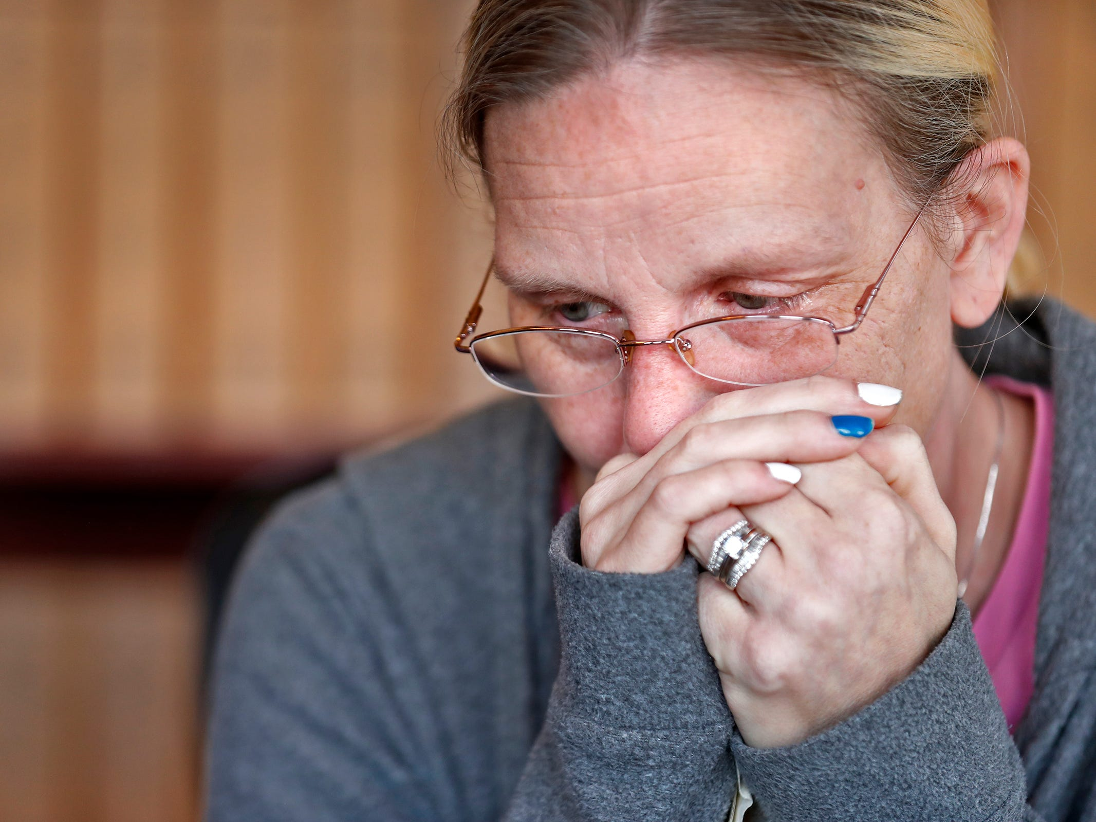 Heidi Curtis pauses while she and her husband Dave Curtis talk about their daughter Charly, Thursday, Feb. 21, 2019. Charly was born with a genetic condition that eventually led her to develop grand mal seizures. After trying many medications that would work at first then become ineffective, they eventually tried treating her with THC, which has been known to help children with seizures.  But in Indiana, that meant going through a lot of bureaucratic red tape.  When their THC was about to run out, Charly's father drove to Colorado to replenish their supply.  In his absence, Charly had a seizure and died.  The New Castle family wants to share their story to promote the legalization of medical marijuana.