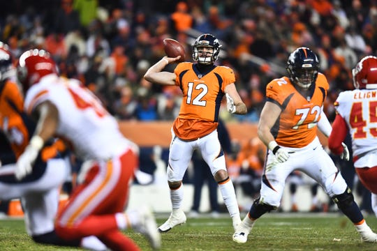 Dec 31, 2017; Denver, CO, USA; Denver Broncos quarterback Paxton Lynch (12) attempts a pass during the second half against the Kansas City Chiefs at Sports Authority Field at Mile High.