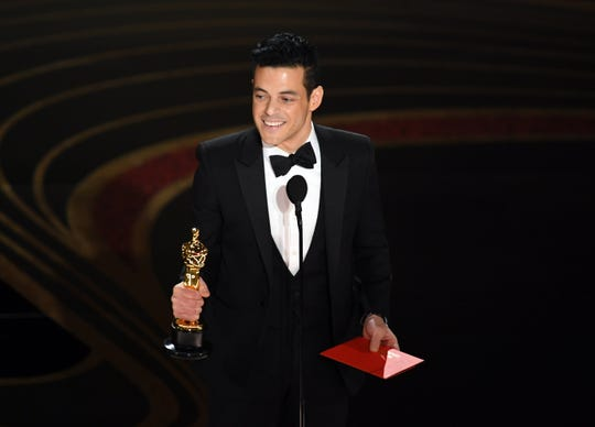 Rami Malek accepts his Academy Award Sunday in Los Angeles.