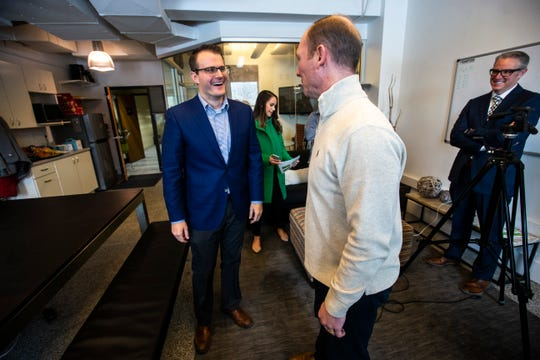 Iowa Lt. Gov. Adam Gregg, left, talks with Rantizo CEO Michael Ott, Monday, Feb. 25, 2019 at Rantizo in Iowa City, Iowa. Rantizo is a targeted <a href=http://www.dronefromchina.com/product/products-2-9.html target='_blank'>drone sprayer</a> company.