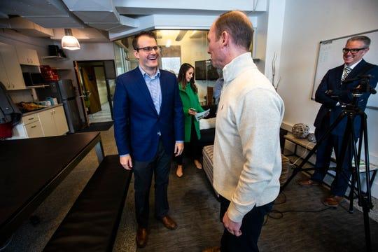 Iowa Lt. Gov. Adam Gregg, left, talks with Rantizo CEO Michael Ott, Monday, Feb. 25, 2019 at Rantizo in Iowa City, Iowa. Rantizo is a targeted drone sprayer company.