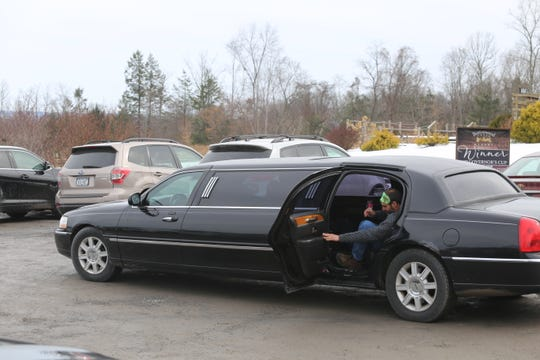 Tom Horvath, of Upper Black Eddy, Pennsylvania, exits a limo in the parking lot of Buttonwood Grove Winery in Romulus, New York, during a Mardi Gras event.