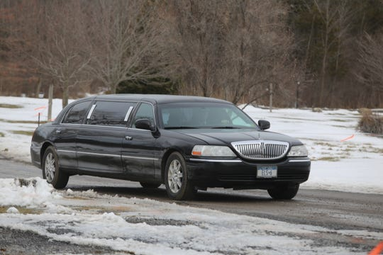 A limousine pulls into Buttonwood Grove Winery in Romulus, New York, during a Mardi Gras event held on Feb. 23, 2019.