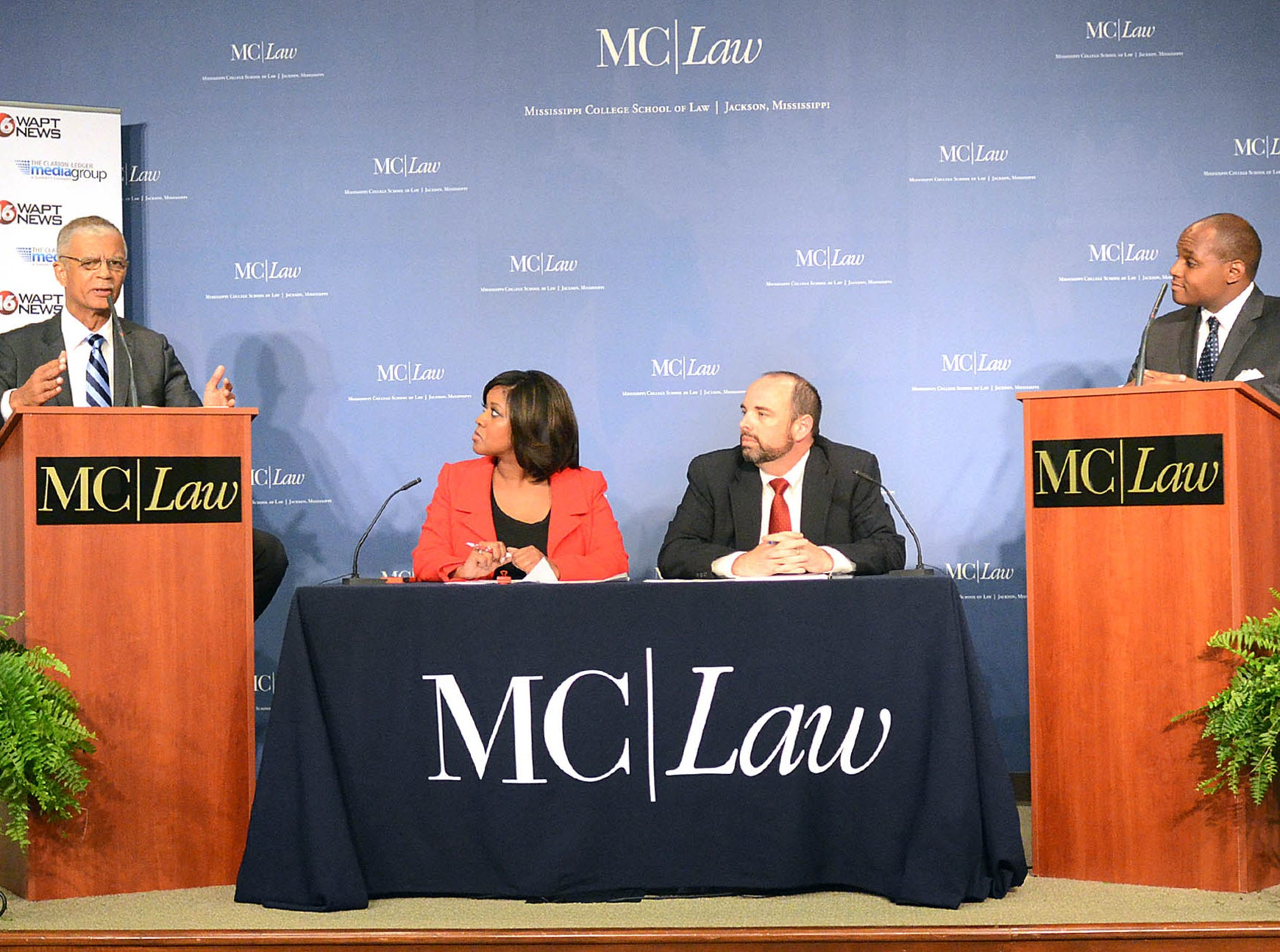 Jackson mayoral candidates Chokwe Lumumba, left, and Jonathan Lee, right, face off in a debate Friday at Mississippi College School of Law.