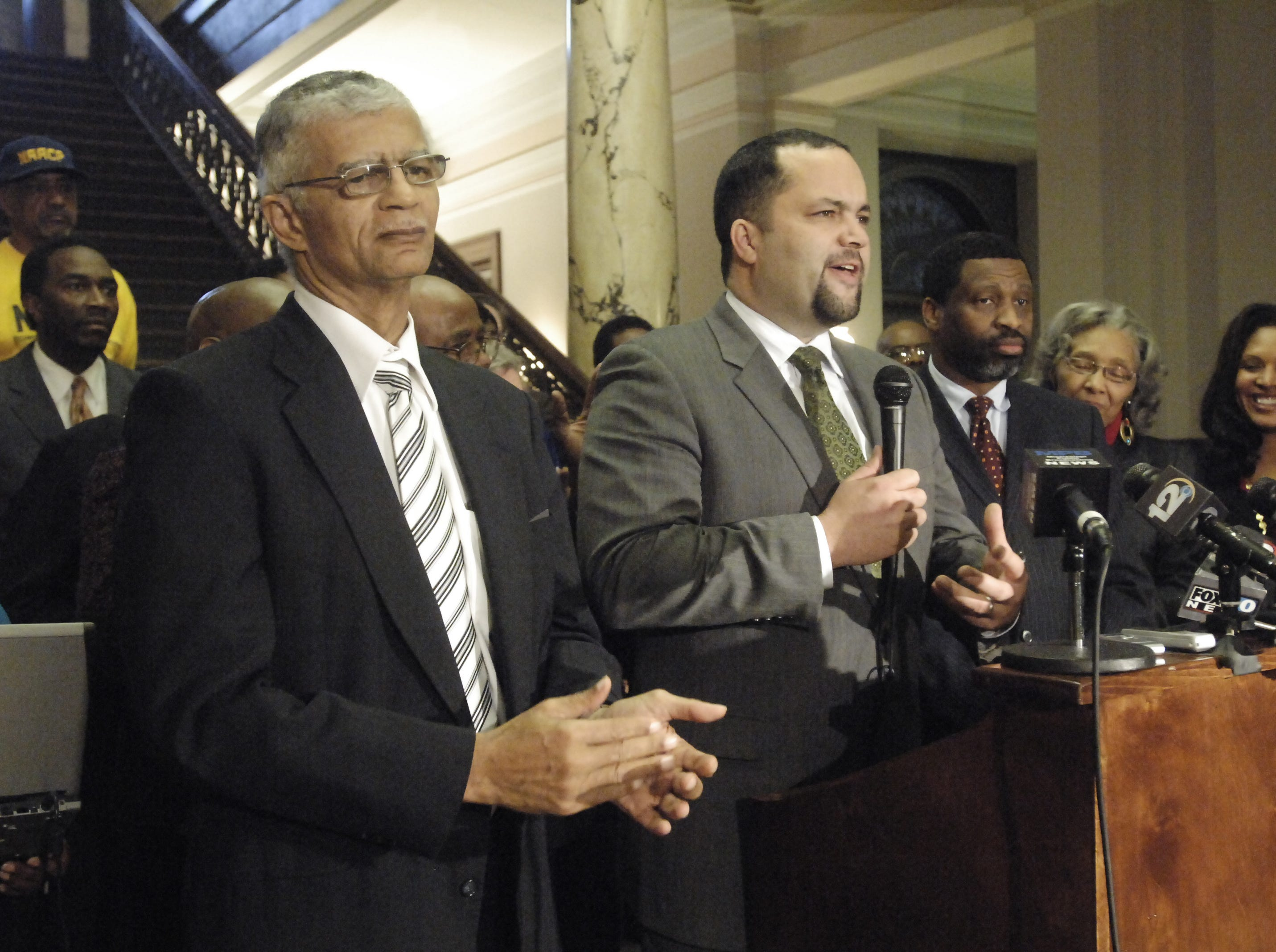 Flanked by attorney Chokwe Lumumba (left) and Ms. NAACP's Derrick Johnson (right), NAACP President and CEO Ben Jealous talks about the release of sisters Jamie and Gladys Scott.